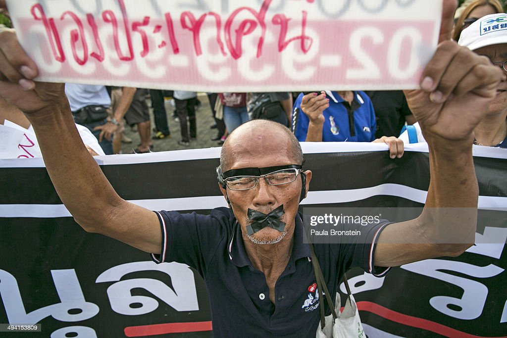 A protester tapes his mouth closed during anti-coup protests on May 28, 2014 in Bangkok, Thailand. Widespread Facebook outage occurred in Thailand on Wednesday afternoon while the ruling military junta who staged a coup last week denied that they caused it. The Thai military has warned Thai citizens about expressing dissent using social media. Thailand is known as a country with a very unstable political record and is now experiencing it's 12th coup with 7 attempted pervious coups.
