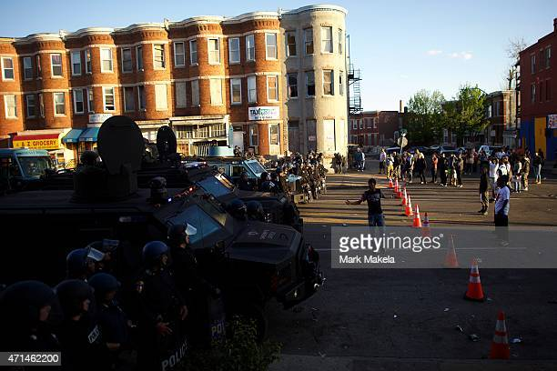 Protester taunts riot police the afternoon after citywide riots over the death of Freddie Gray on April 28, 2015 in Baltimore, Maryland. Freddie Gray...