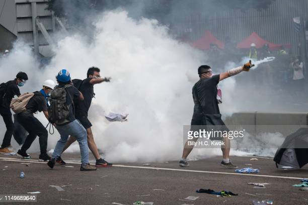 Protester throw back the tear gas during a protest against a proposed extradition law on June 12 2019 in Hong Kong Hong Kong Large crowds of...