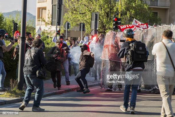 A protester throwing flare to the policemen Hundreds of protesters are met in Lucca to show their disapproval for the G7 meeting the meeting of...