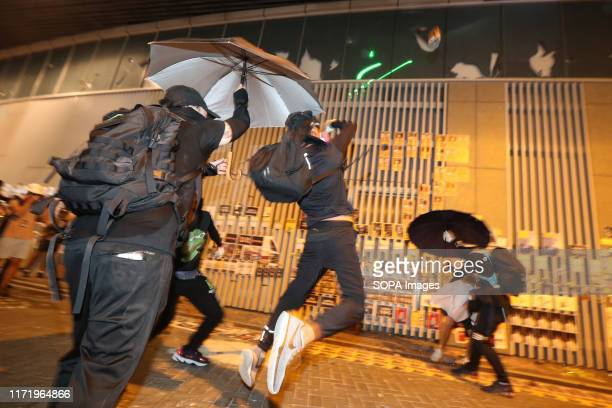 Protester throws a brick to the legislative Council during the rally Demonstrators gathered for an antiauthoritarian rally that marked the 5th...