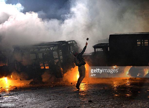 A protester throws a stone during the clash with the police in the centre of the Ukrainian capital Kiev on January 20 after 200000 turned up for an...