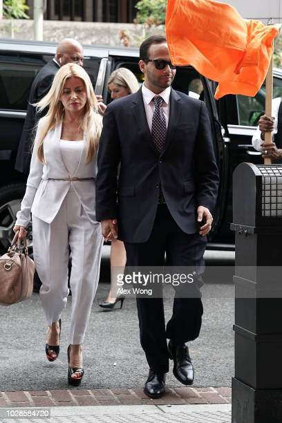 A protester throws an orange Tshirt as former Trump Campaign aide George Papadopoulos arrives with his wife Simona Mangiante at the US District Court...