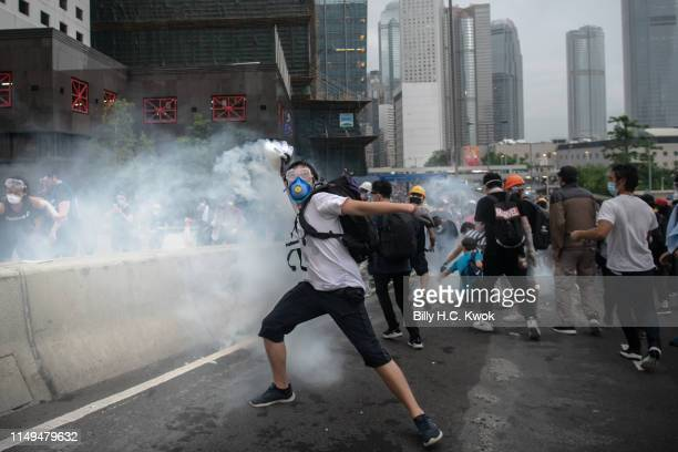 Protester throws back the tear gas during a protest against a proposed extradition law on June 12 2019 in Hong Kong Hong Kong Large crowds of...