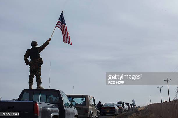 Protester Tom Wagner shows his support at the Malheur Wildlife Refuge Headquarters near Burns Oregon on February 11 2016 The FBI surrounded the last...