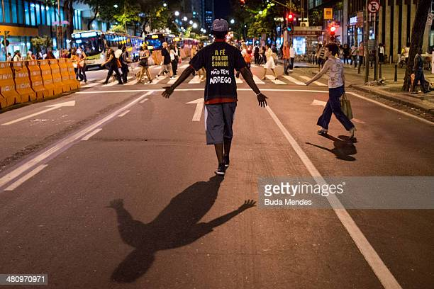 A protester tries to disrupt traffic during a demonstration against the 2014 FIFA World Cup Brazil at Central do Brasil train station on March 27...