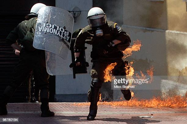 A protester uses molotov cocktails against riot police during May Day protests on May 1 2010 in Athens Greece Thousands of protesters gathered in...