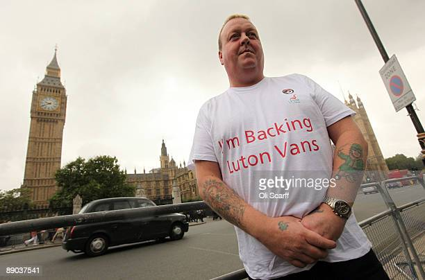 A protester waits for a convoy of Vauxhall cars to drive around Parliament Square in Westminster in a campaign to safeguard workers' jobs on July 15...