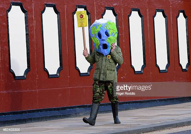 A protester walks past a council meeting to decide on two sites in Lancashire for fracking plants at Lancashire County Hall on January 28 2015 in...
