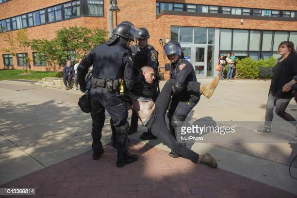 A protester was arrested by the police and was nonresponsive The police attempted to carry him away before realizing he was totally limp and not...