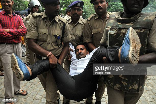 A protester was carried by the policemen during the protest against Prime Minister Nawaz and Abdul Qadeer Indian youth congress launched protest...
