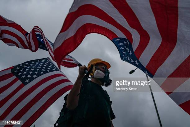 A protester waves a American flag on a street during a demonstration in Tai Wan on August 10 2019 in Hong Kong China Prodemocracy protesters have...