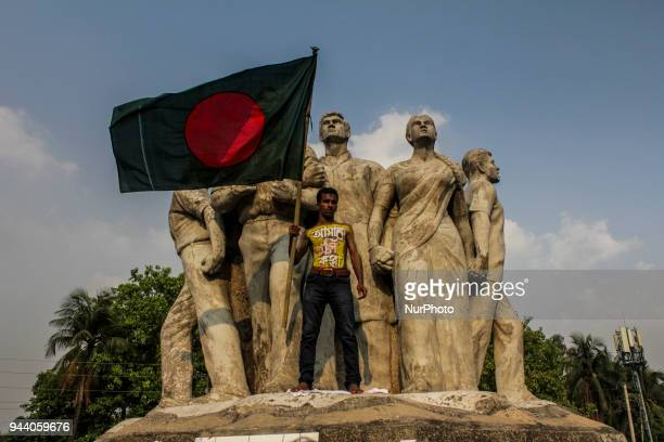 A protester waves a Bangladeshi flag during a demonstration by the students of Dhaka University in Dhaka Bangladesh on April 9 to protest against the...