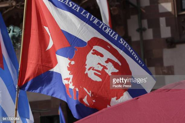A protester waves a Cuban flag with the picture of Che Guevara on it Thousands of people from several peace organisations as well as different...