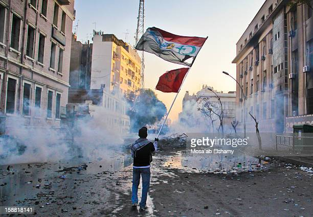 CONTENT] A protester waves a flag amid clouds of tear gas smoke during clashes with security forces around Tahrir square The clashes erupted after...