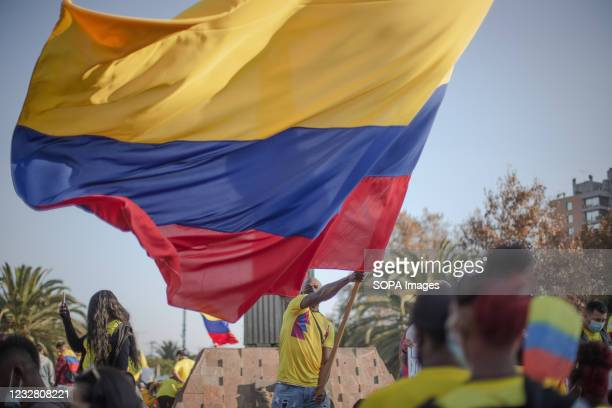 Protester waves a flag during the demonstration. Colombian residents in chile protest in solidarity with their country and against Ivan Duque's...