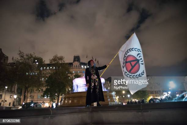A protester waves a flag mask in Trafalgar Square during the anticapitalist 'Million Masks March' organised by the group Anonymous to protest...