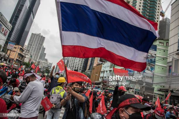 Protester waves a Flag of Thailand during the car mob rally. Anti-government protesters gathered at Asok intersection before they drove their...
