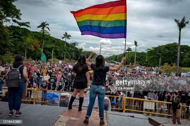 A protester waves a pride flag during a protest against President Duterte's AntiTerror bill on June 12 2020 in Quezon city Metro Manila Philippines...