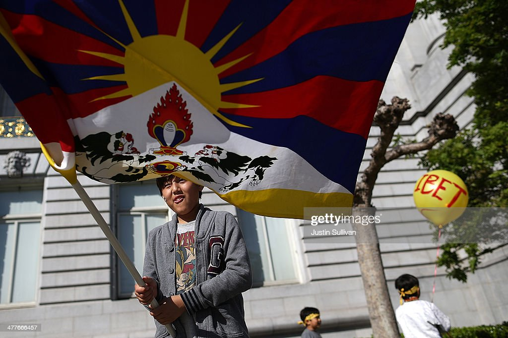 A protester waves a Tibetan flag during a demonstration outside of San Francisco City Hall on March 10, 2014 in San Francisco, California. Hundreds of activists marked the 55th anniversary of the 1959 Tibetan uprising and the fifth anniversary of Tibetan self-immolation protests in Tibet.