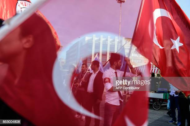 A protester waves a Turkish flag on September 24 2017 in Istanbul during a demonstration against referendum in northern Iraq Iraqi Kurds are...