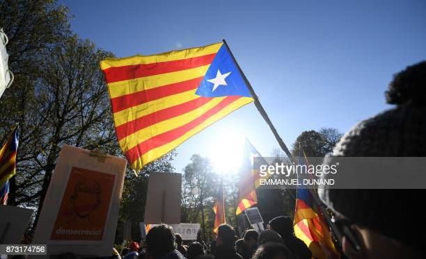 A protester waves the Estelada Catalan independentist flag during a demonstration by proCatalan independence supporters calling for the release of...