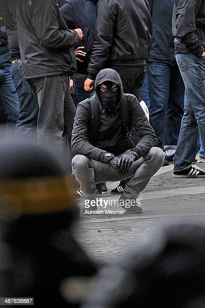 A protester wearing a balaclava looks on at the Police during an anti fascist demonstration on May 1 2014 in Paris France The demonstration was held...