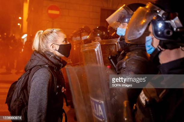 Protester wearing a face mask as protective measure confronts the riot police during an anti-government protest. For the 25th consecutive Friday,...