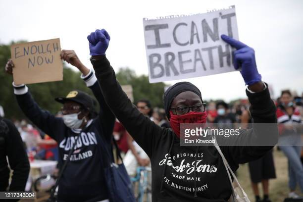 Protester wearing a face mask holds a sign saying 'I can't breathe' during a Black Lives Matter protest in Hyde Park on June 3, 2020 in London,...