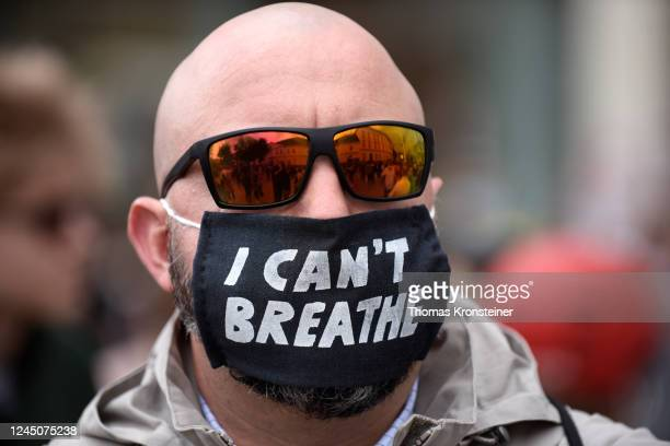 A protester wearing a face mask reading 'I can't breathe' during a Black Lives Matter march on June 04 2020 in Vienna Austria The death of an...