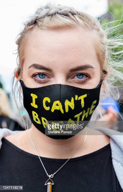 "Protester, wearing a face mask that says ""I Can't Breathe"", during a Black Lives Matter demonstration in Piccadilly Gardens on June 06, 2020 in..."