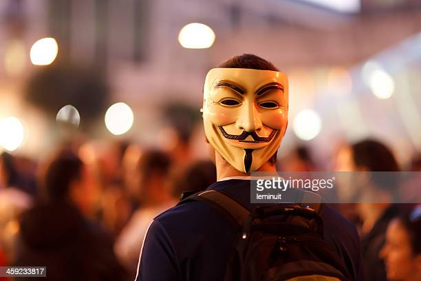 protester wearing a guy fawkes mask. - unrecognizable person stock pictures, royalty-free photos & images