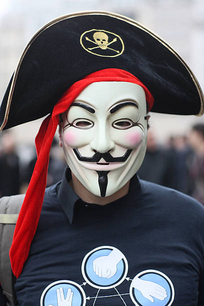 Protester wearing a Guy Fawkes mask , trademark of the Anonymous movement and based on a character in the film V for Vendetta.