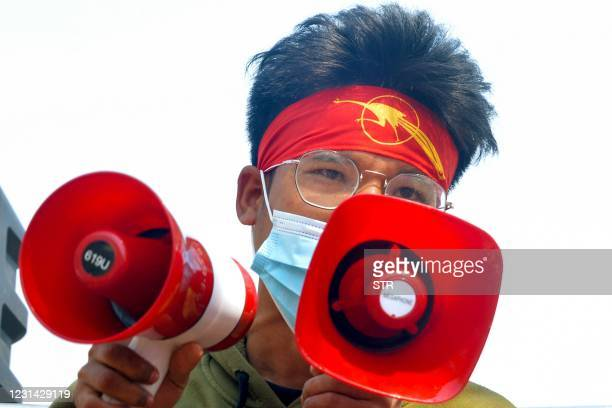 Protester wearing a headband featuring the Students Union logo addresses the crowd during a demonstration against the military coup in Naypyidaw on...