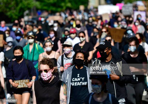 A protester wearing a I CAN'T BREATHE tshirt marches through Center City on June 1 2020 in Philadelphia Pennsylvania Demonstrations have erupted all...