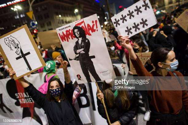 A protester wearing a mask holds a placard of Sigourney Weaver as Ellen Ripley who became the symbol of women's resistance in Poland during the...