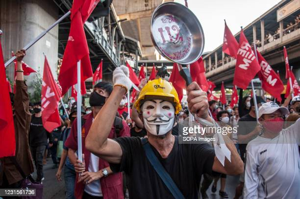 """Protester wearing a mask is seen banging a saucepan with massage """"Abolish 112"""" during the demonstration. The pro-democracy protesters led by REDEM..."""