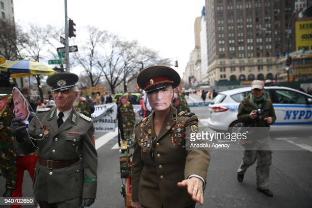 A protester wearing a mask of Vladimir Putin attends the April Fools Day Parade by Trump Tower on the Fifth Avenue in New York City United States on...