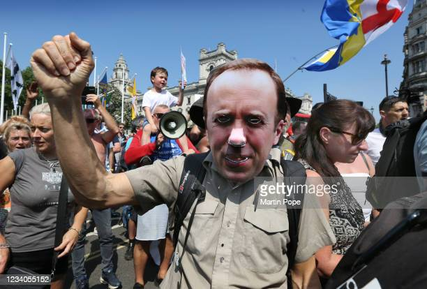 Protester wearing a Matt Hancock mask calls for the arrest of Matt Hancock in Parliament Square part of a freedom protest on July 19, 2021 in London,...