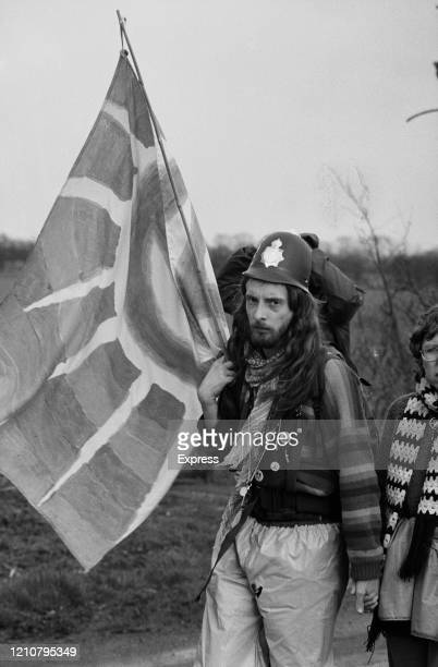 A protester wearing a policeman's helmet during a Campaign for Nuclear Disarmament demonstration at the Royal Airforce base near Molesworth...