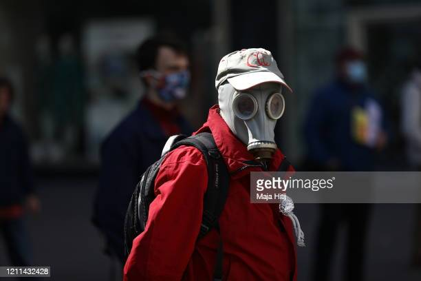 A protester wearing a protective face mask demonstrates while maintaining social distancing on May Day during the novel coronavirus crisis on May 1...