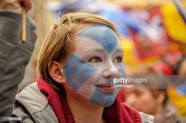 Protester wearing a Saltire facepaint smiles during the march. Thousands of Scottish independence supporters marched through Edinburgh as part of the...