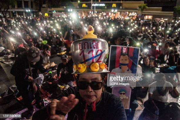 """Protester wearing a saucepan on his head with a message """"Abolish 112"""" while raising a three finger salute during the demonstration. A group of..."""