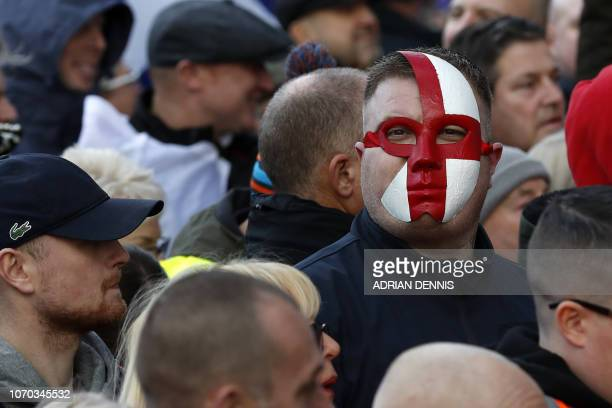 A protester wearing a St George's flag mask attends a proBrexit demonstration promoted by UKIP in central London on December 9 as the crucial vote on...
