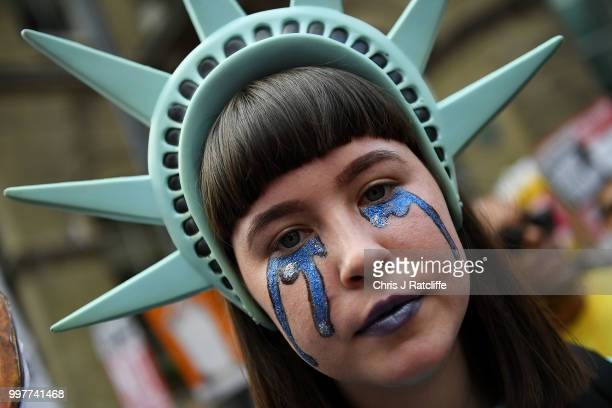 A protester wearing a Statue of Liberty hat takes part in a demonstration against President Trump's visit to the UK near Portland Place on July 13...