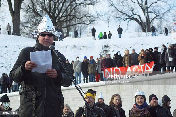 A protester wearing a tinfoil hat delivers a speech during a demonstration against controversial AntiCounterfeiting Trade Agreement as part of an...