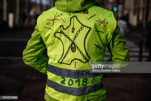 TOPSHOT A protester wearing a 'Yellow Vest' reading 'All together' near the Chateau de Versailles in Versailles outside Paris on December 22 2018 The...