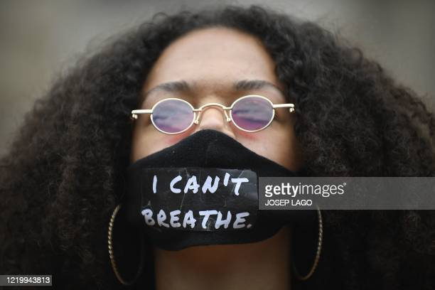 A protester wears a face mask reading I can´t breathe during a demonstration in Barcelona on June 14 as part of the worldwide protests against racism...