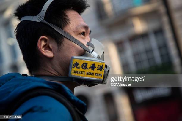 Protester wears a gas mask written on Liberate Hong Kong during the demonstration. About 50 Hong Kong supporters gathered in Piccadilly Circus in...