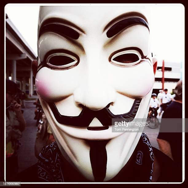A protester wears a Guy Fawkes mask August 29 2012 in Tampa Florida Day 3 of the Republican National Convention convenes today with US vice...